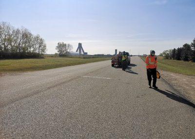 Worker working on the asphalt road