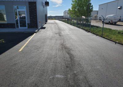 Asphalt parking lot in front of store