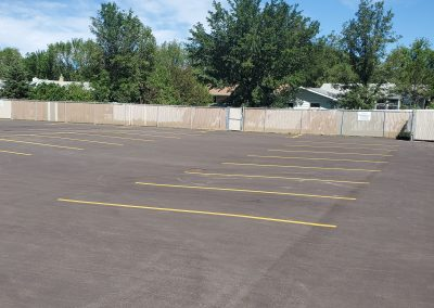 Asphalt parking lot with yellow marking